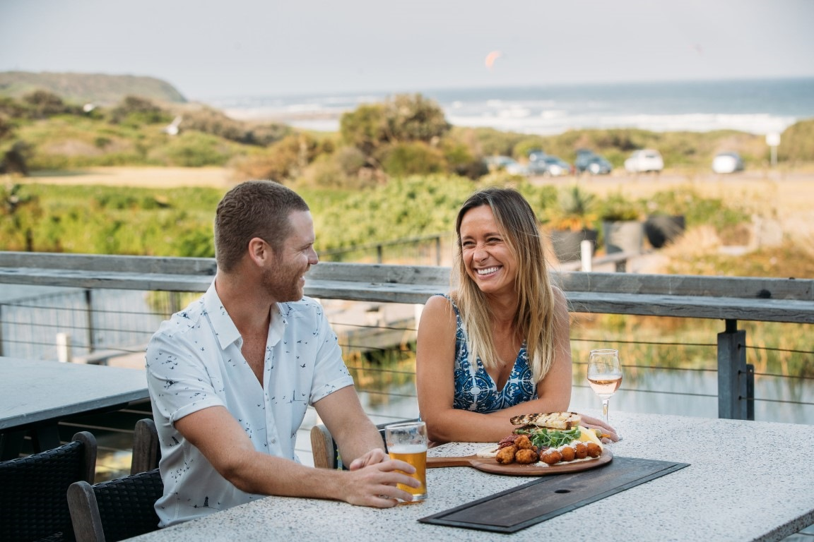 Sunset drinks at Caves Beach & Bungalows